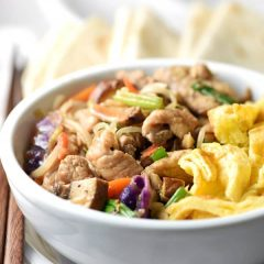 Make Moo Shu Pork at home! This recipe is packed with delicious fresh ingredients all rolled up in a tortilla for a fun and utensil-free 30 minute meal, perfect for busy weeknights.