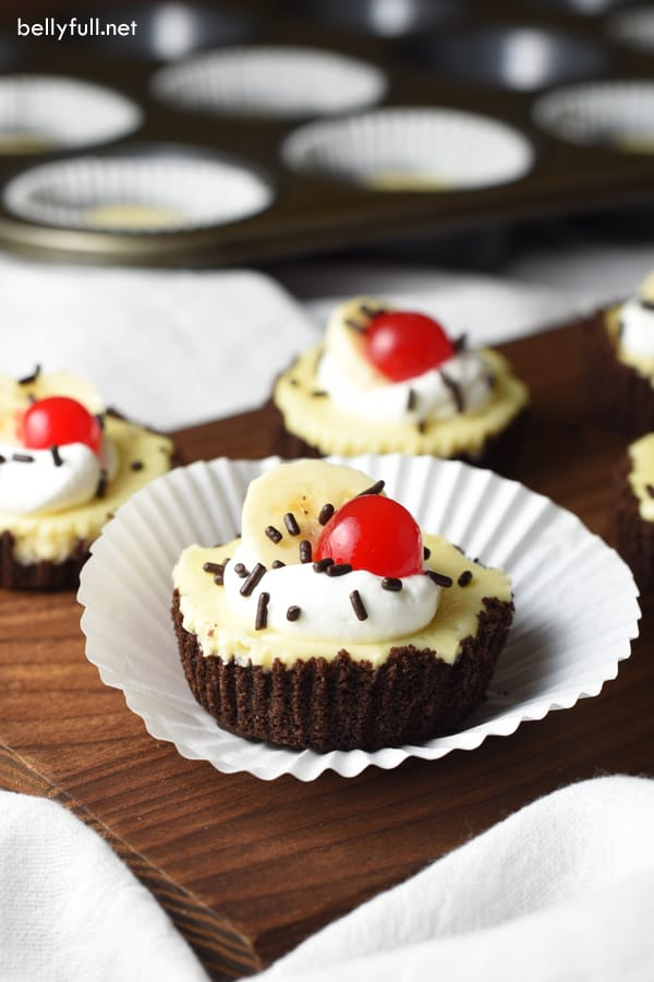 Banana Split Mini Cheesecakes - classic banana split flavors and your favorite cheesecake come together here in single servings. So delicious and fun!