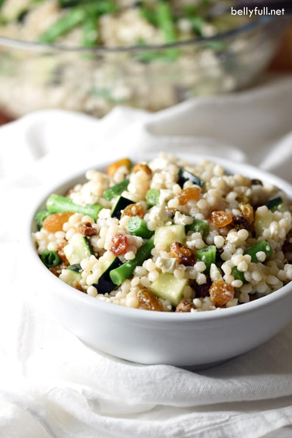 This Israeli Couscous Salad is a wonderfully light salad with sweet raisins, salty feta cheese, and crunch from green beans, cucumber, and pistachios. A lot of layers and flavors in this one!