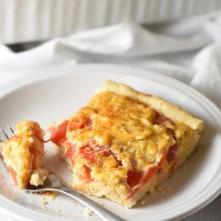 Cheesy Tomato Biscuit Casserole - a flavor-packed cheese and herb mixture tops biscuits and fresh tomatoes in this easy and delicious casserole!