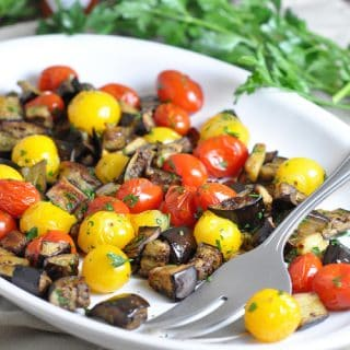 A simple and flavorful vegetarian side with eggplant, tomatoes, parsley, and hot sauce. Roasted to perfection!