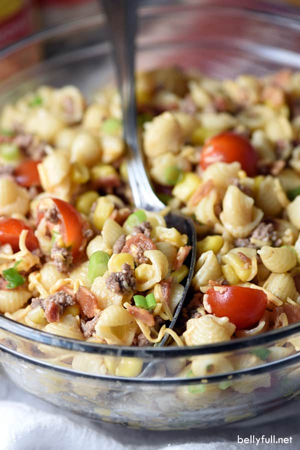 Bacon, ground beef, cheese, and hot sauce make this Cowboy Pasta Salad a definite crowd pleaser! Perfect for summer get togethers.