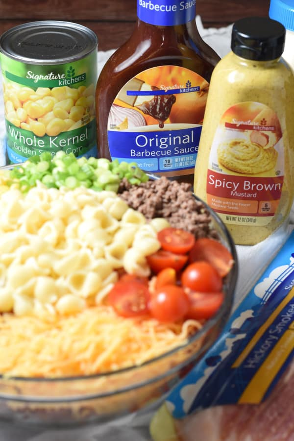Bacon, ground beef, cheese, and hot sauce make this Cowboy Pasta Salad a