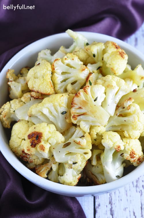 Parmesan Roasted Cauliflower - sweet cauliflower tossed in olive oil, garlic, thyme, and Parmesan cheese, and roasted until tender and golden.