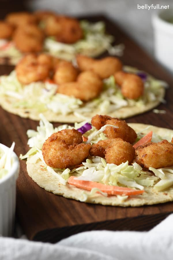 These Popcorn Shrimp Tacos with Cilantro Lime Sauce are so delicious and a lifesaver for busy weeknights!