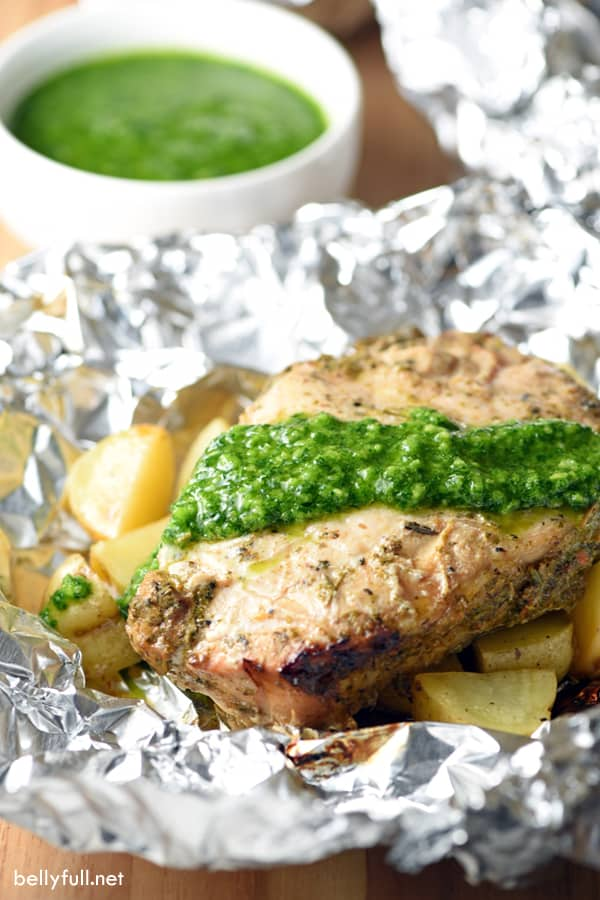 A foil packet recipe for the grill, filled with seasoned pork chops, baby potatoes, and finished with a robust Chimichurri sauce! Perfect for weeknight and summer cooking!