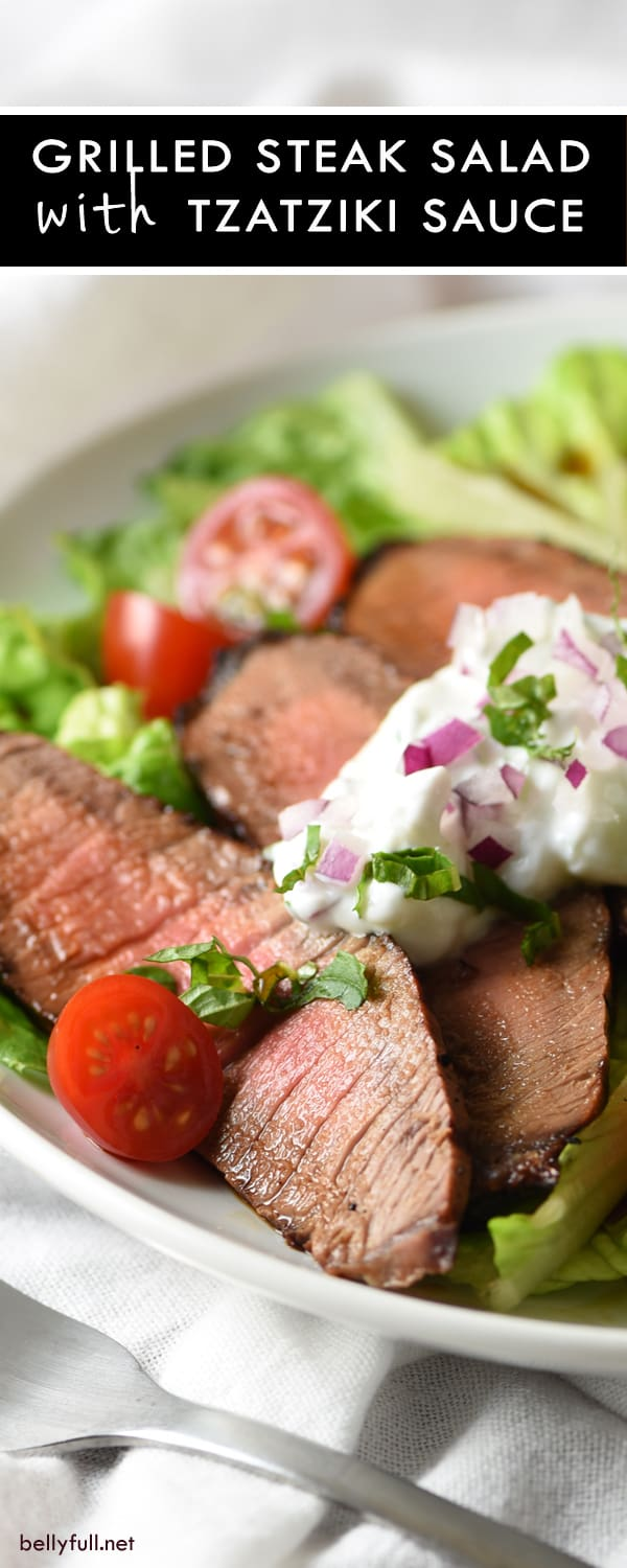 Grilled Steak Salad with Tzatziki Sauce - tender marinated steak is served on top of salad with a light and refreshing yogurt sauce for an easy, low-calorie meal!
