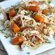 Slow Cooker Garlic and Brown Sugar Chicken - chicken and baby carrots slow cook all day in a sweet and slightly spicy sauce, then served over rice for a complete meal!