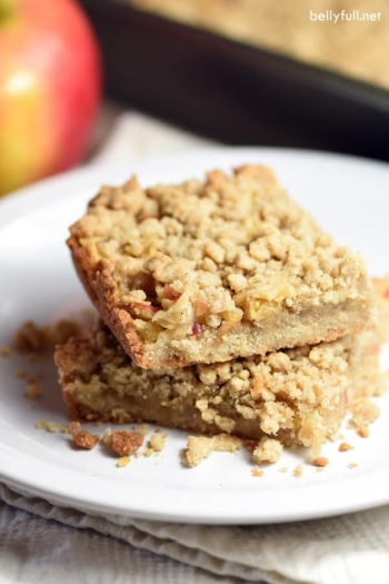 These Apple Crumble Bars are dessert squares that resemble apple pie, with a crumble bottom and top, and shredded cinnamon apples in between. Perfect for Fall baking!