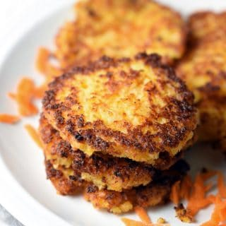 These Potato Carrot Latkes are the classic potato latke - or potato pancake, if you prefer - with added carrots. Perfect for Jewish holidays and Thanksgiving!