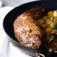 Pork tenderloin is marinated in garlic and cracked black pepper seasonings, then cooked in a skillet with brussels sprouts, butternut squash, and bacon. Easy, delicious, and perfect weeknight Fall dinner!