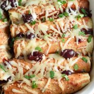 These Cranberry Turkey Enchiladas are THE BEST use of Thanksgiving leftovers ever!