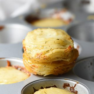 The classic gratin gets a makeover, where thinly sliced potatoes are tossed with cream and dill, stacked in muffin tins for individual portions, sprinkled with Gruyere, then baked!