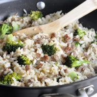 A delicious and easy weeknight meal all in one pot, featuring baked rice, sausage, and broccoli.