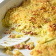 This is The Best Yellow Squash Casserole! Thinly sliced squash is combined with sautéed bacon and onion, cheese, crackers, and a buttery egg mixture. Perfect for any brunch or holiday get togethers!