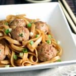 Traditional meatballs with an Asian twist, using ground pork, soy and hoisin sauces. Then served over sesame rice noodles for an easy and complete meal!
