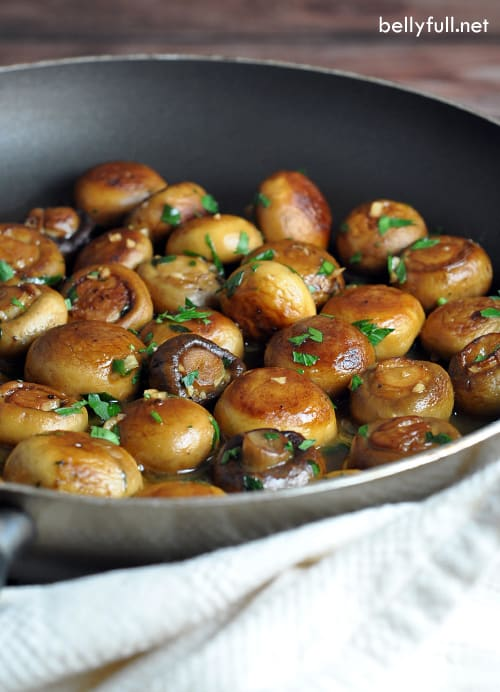 Two kinds of mushrooms are Sauteed in butter, olive oil, garlic, wIne, and lemon juice, which creates a wonderful pan sauce!