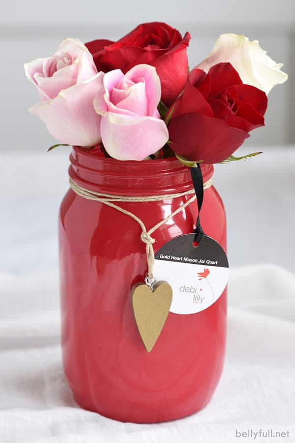 red vase with roses