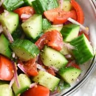 This Cucumber Tomato Salad is a classic summer staple that is a potluck favorite. Enjoy all on its own or serve it with fish, chicken, pork, or grilled steak!