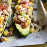 Taco Zucchini Boats are hollowed out zucchini, stuffed with all your favorite taco ingredients. Gluten free and healthy, these make a delicious appetizer, side dish, or main meal! #StuffedZucchini #ZucchiniBoats #tacos #glutenfree