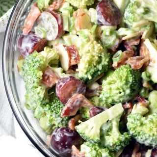 This classic broccoli salad with almonds, grapes, dried cherries, and bacon, will be your go-to for every potluck!