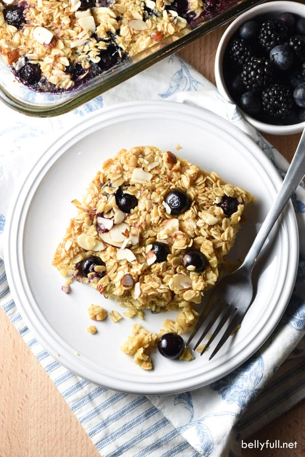 overhead picture of baked oatmeal with blueberries on white plate