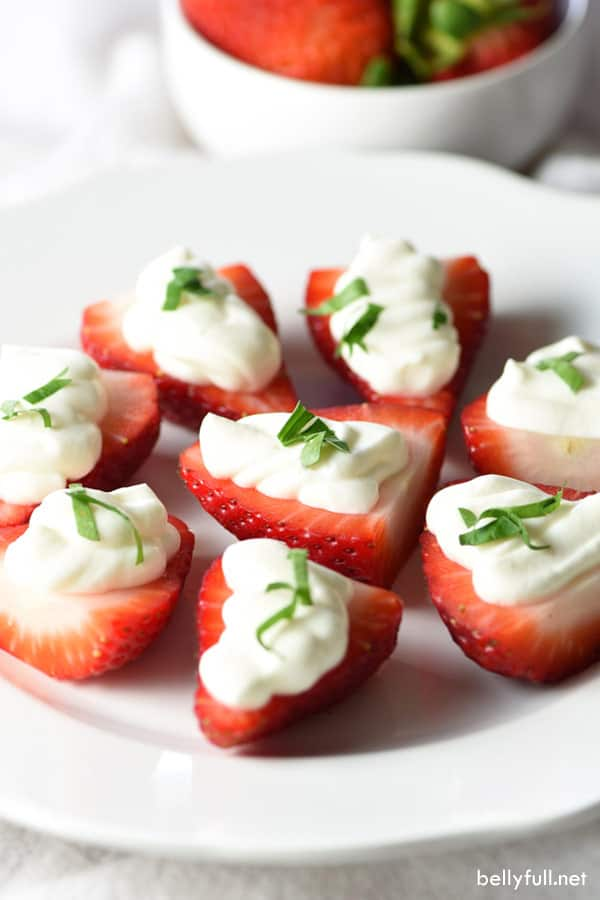 Cheesecake Mousse Strawberries - Freshly hulled strawberries are stuffed with an amazing cheesecake mousse. Eat as a snack or serve as a healthy dessert!