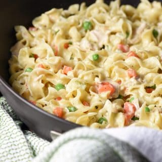 Classic chicken pot pie transformed into a skillet dish with noodles instead of a crust. Easy delicious weeknight meal!