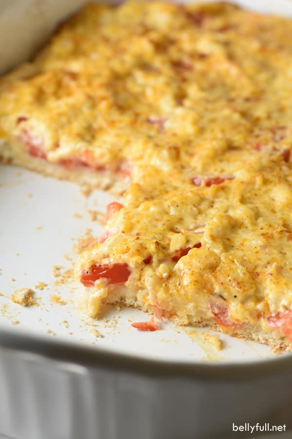A flavor-packed cheese and herb mixture tops biscuits and fresh tomatoes in this easy and delicious Cheesy Tomato Biscuit Casserole!