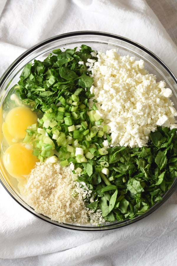 ingredients for a spanakopita recipe in a bowl