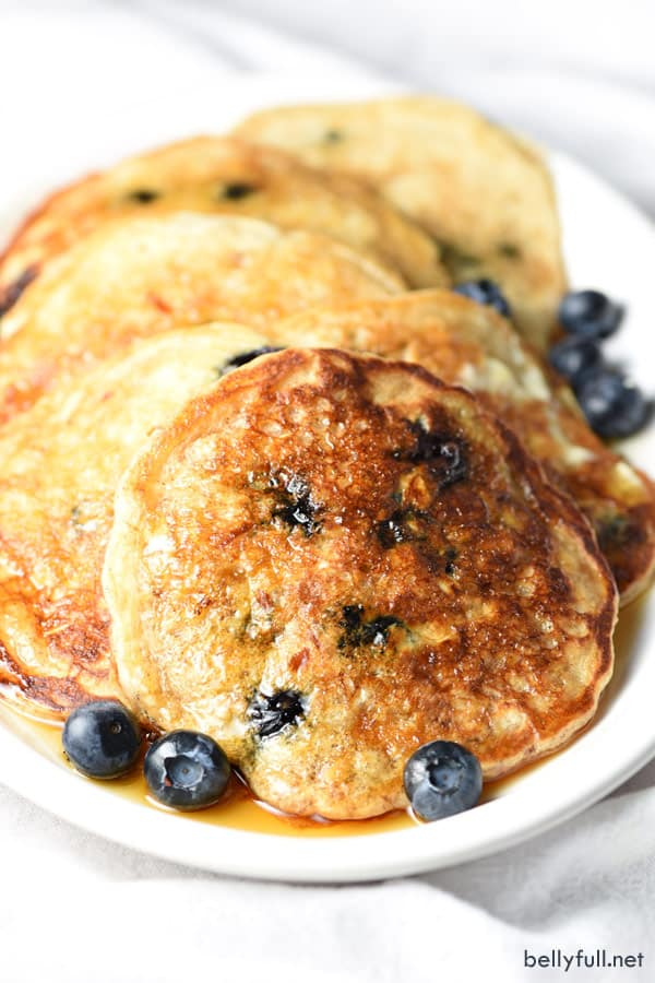 Light and healthier pancakes made with oats and fresh blueberries!
