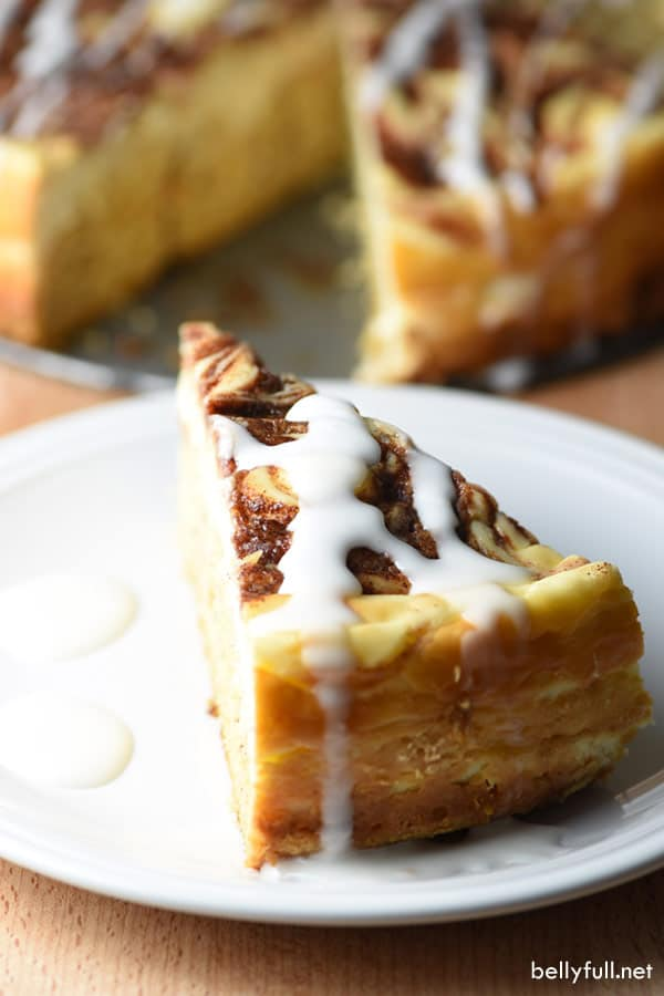 slice of Cinnamon Roll Cheesecake on white plate