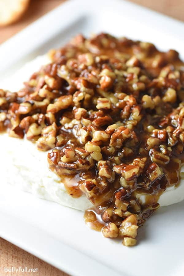 Easy sweet and salty French Quarter Cheese Spread. Topped with sugared pecans, it makes a festive appetizer for holiday gatherings!