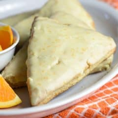 These Orange Creamsicle Scones are tender and flaky, with fresh orange zest throughout and a dreamy orange glaze!