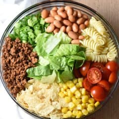This Southwestern Pasta Salad is loaded with goodies and coated in a kicked up zesty southwestern dressing. It's like a giant deconstructed taco! Great for get togethers.