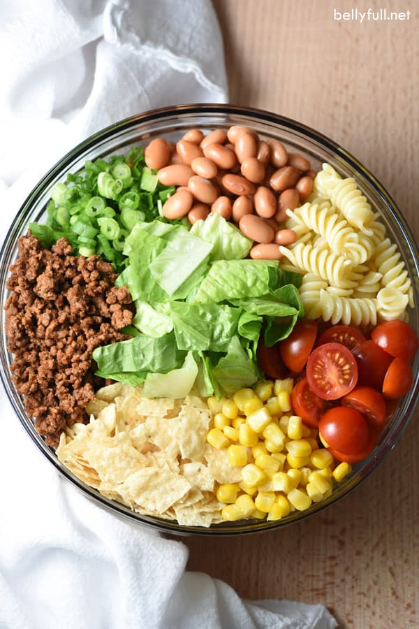 overhead picture of southwestern pasta salad ingredients in glass bowl