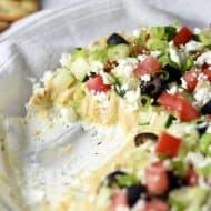 Be whisked away to the Mediterranean with this bright, fresh, and delicious Layered Greek Dip! Perfect for a get together or afternoon snack. Super easy and fast to make!