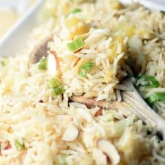 Pineapple Coconut Rice is a mild and light tropical side that pairs perfectly with sweet and sour or teriyaki chicken.