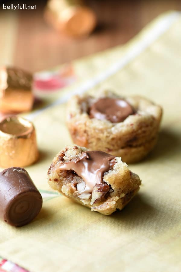 These Praline Rolo Cups are Rolos candy stuffed inside sugar cookie dough that's been blended with toffee bits and pecans. Such an easy and fun treat!