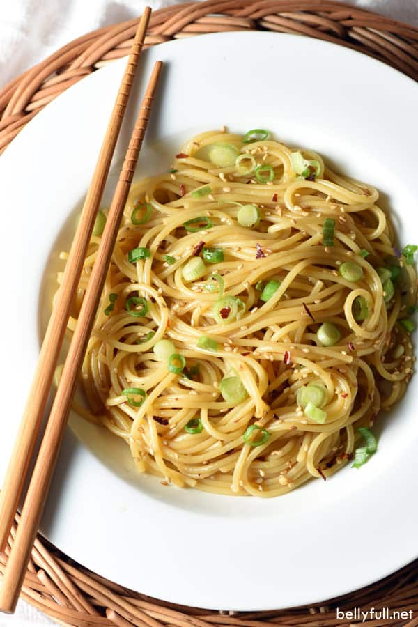 overhead picture for sesame noodles in white bowl with chopsticks