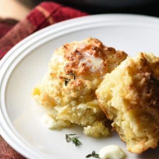 Sharp cheddar cheese, tart apples, and sweet buttermilk come together in these tender and delicious Cheddar-Apple Skillet Drop Biscuits. Hurry, get out your cast iron skillet!
