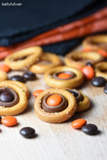 These Halloween Pretzel Rings are the easiest sweet and salty treat incorporating, pretzels, a Hershey's kiss, and M&Ms. Makes as many or as little as you want!