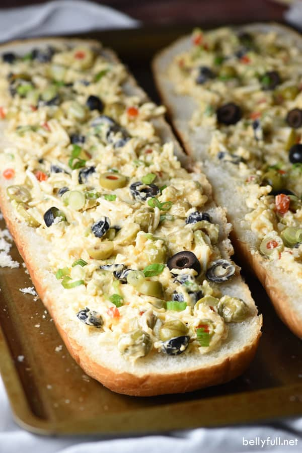 This Olive Cheese Bread is an easy and delicious appetizer with salty olives, gooey cheese, and crunchy bread. Crazy good!
