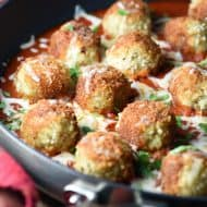 Skillet Chicken Parmesan Meatballs is your favorite Chicken Parmesan, but in meatball form. Serve with a simple side salad for a delicious complete dinner!