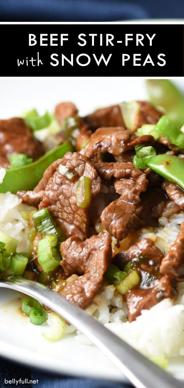 Stir Fry Beef with Snow Peas on top of cooked white rice