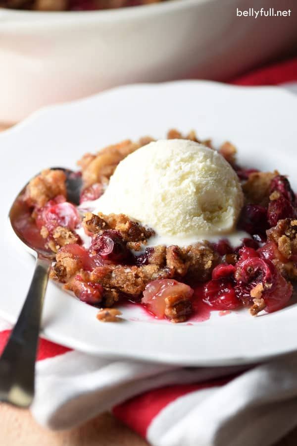 apple cranberry crisp on white plate