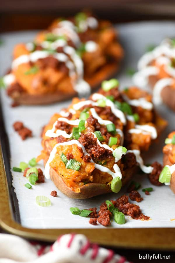 twice baked sweet potatoes with cooked chorizo on a baking sheet