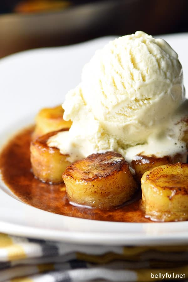 fried bananas on a plate with ice cream on top