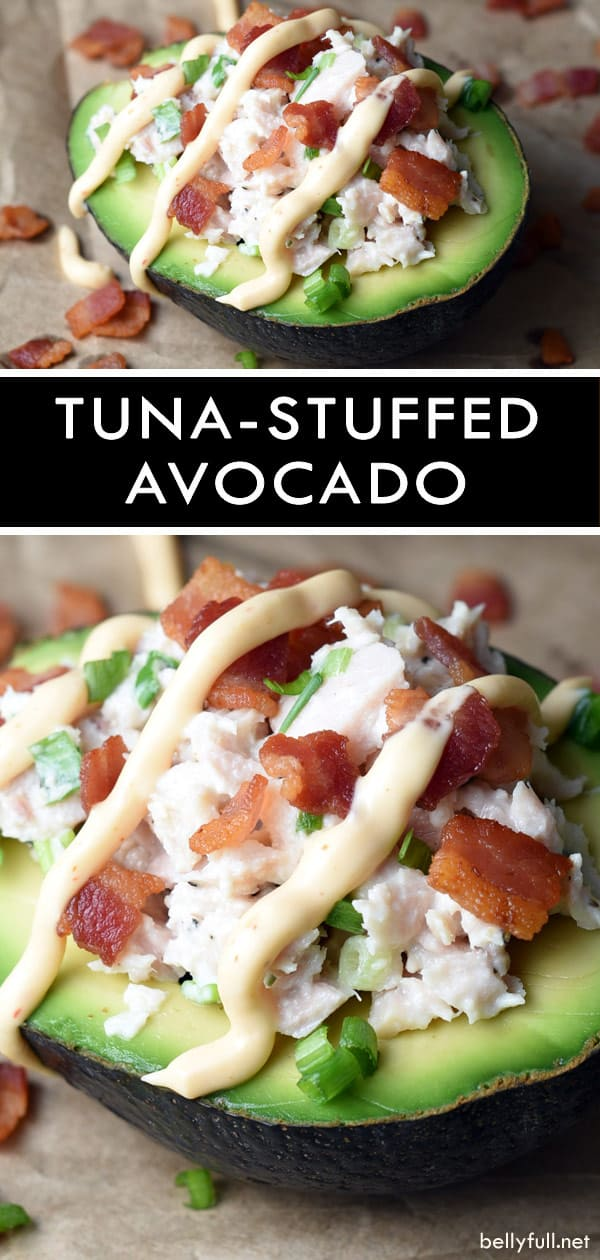 picture of sliced ripe avocado filled with tuna and topped with cooked crispy bacon