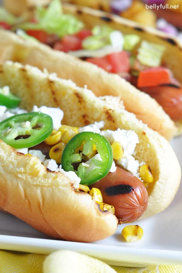 Mexican hot dog with grilled corn, soft cotija cheese, jalapeño peppers